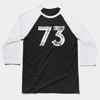 Number 73 printed in white with ink-roller effect on front of black and white baseball t-shirt