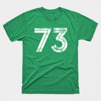 Number 73 printed with a cool ink roller effect on the front of a vintage green t-shirt