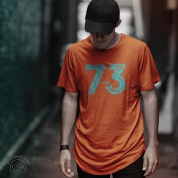 The number 73, roller ink effect, on orange t-shirt, on model, front